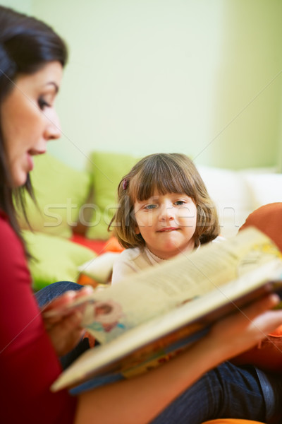 female teacher reading book to little girl Stock photo © diego_cervo