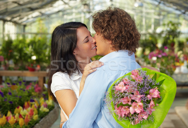 couple kissing in flower nursery Stock photo © diego_cervo