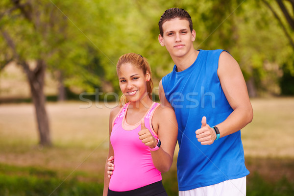 Portrait Young Couple With Thumb Up Doing Sports Training Fitnes Stock photo © diego_cervo