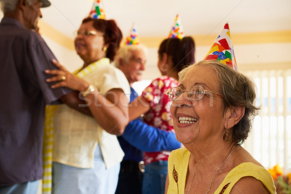 Senior Friends Dancing At Birthday Party In Hospice Stock photo © diego_cervo