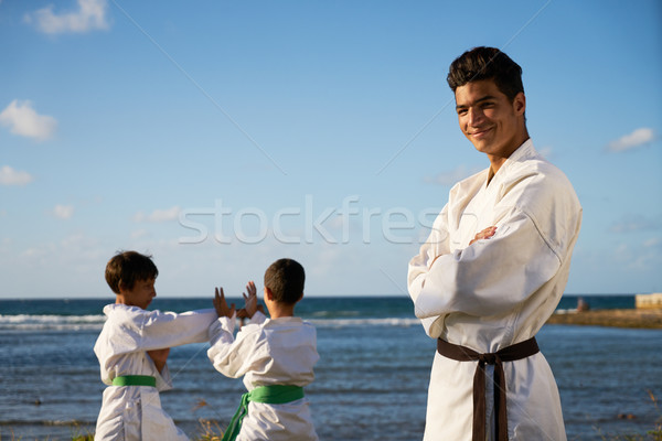 Happy Karate Sport Instructor Watching Young Boys Fighting Stock photo © diego_cervo