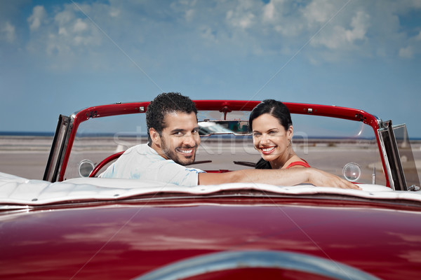 man and beautiful woman hugging in cabriolet car Stock photo © diego_cervo