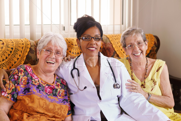 Portrait Of Doctor And Happy Old People In Hospice Stock photo © diego_cervo