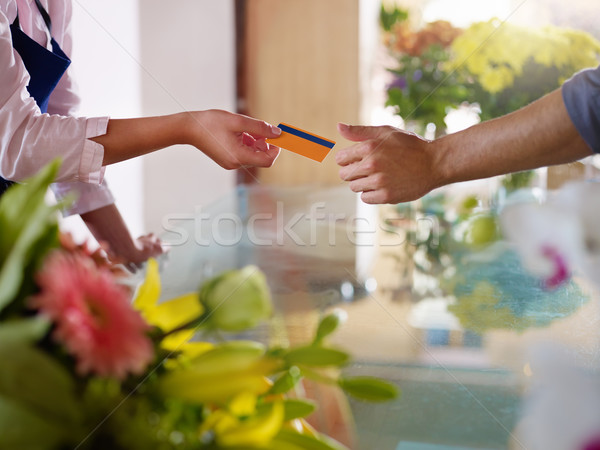client with credit card shopping in flowers shop  Stock photo © diego_cervo