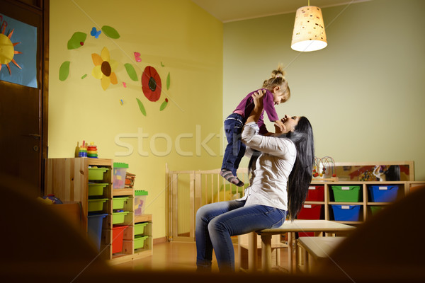 Stock photo: People and fun, teacher playing with little girl at school
