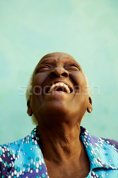 Portrait of funny elderly black woman smiling and laughing Stock photo © diego_cervo