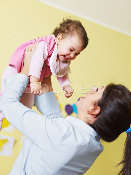 mother playing with her baby Stock photo © diego_cervo