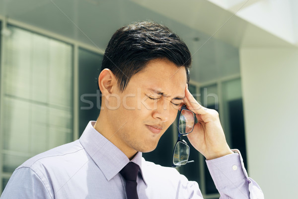 Chinese Man With Eyeglasses Suffers Myopia And Headache Stock photo © diego_cervo