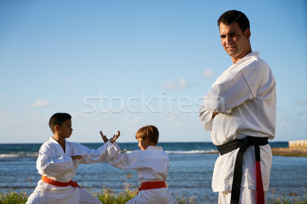 Portrait Of Confident Karate Trainer Watching Children Fight Stock photo © diego_cervo