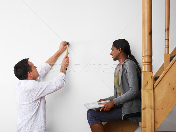 man and woman doing diy work at home Stock photo © diego_cervo