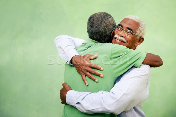 Old friends, two senior african american men meeting and hugging Stock photo © diego_cervo