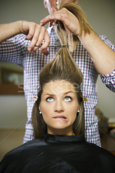 nervous woman in hairdresser shop cutting long hair Stock photo © diego_cervo