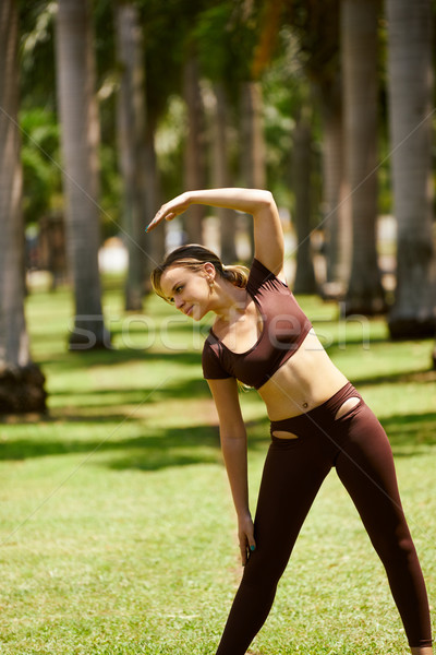 Woman Doing Stretching Before Sport Training At Morning-4 Stock photo © diego_cervo
