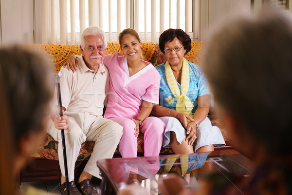 Portrait Of Nurse And Happy Old People In Hospice Stock photo © diego_cervo