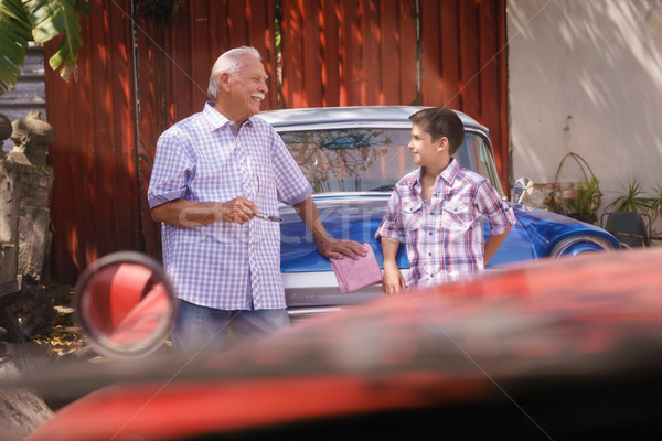 Grandfather Telling History Of Vintage Car To Grandson Stock photo © diego_cervo