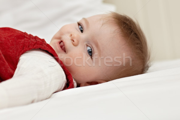 little girl lying on bed and smiling Stock photo © diego_cervo
