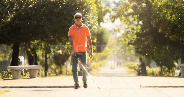 Stock photo: Blind Man Crossing The Street And Walking With Cane