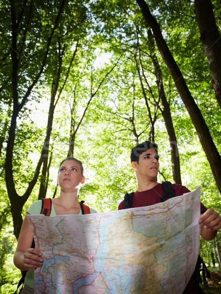 young couple looking at map during trek  Stock photo © diego_cervo