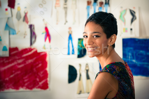 Portrait of happy hispanic young woman working as fashion design Stock photo © diego_cervo