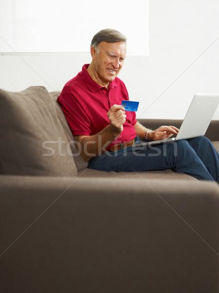 Stock photo: senior man doing online shopping