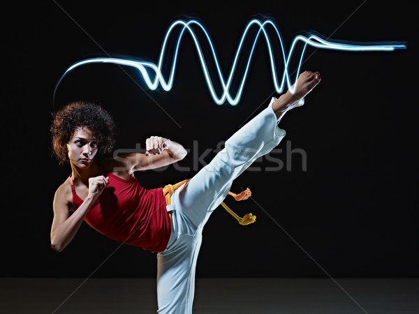 hispanic woman playing capoeira martial art Stock photo © diego_cervo