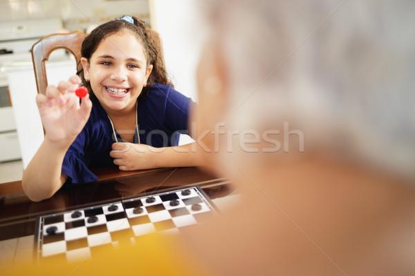 Nonna giocare pronipote home felice Foto d'archivio © diego_cervo