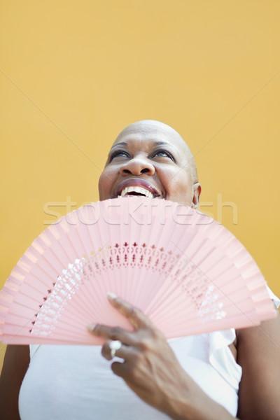 Maturo african donna fan sorridere ritratto Foto d'archivio © diego_cervo