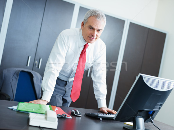 mature businessman in office Stock photo © diego_cervo