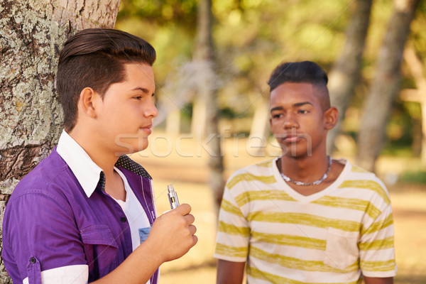 Teenager Boy Smoking E-cig Electronic Cigarette Stock photo © diego_cervo