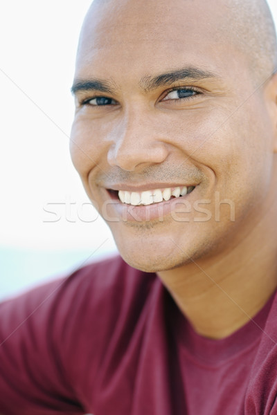 young latino man smiling at camera Stock photo © diego_cervo