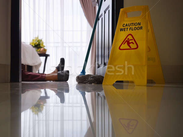 maid slipped on wet floor and laying down Stock photo © diego_cervo