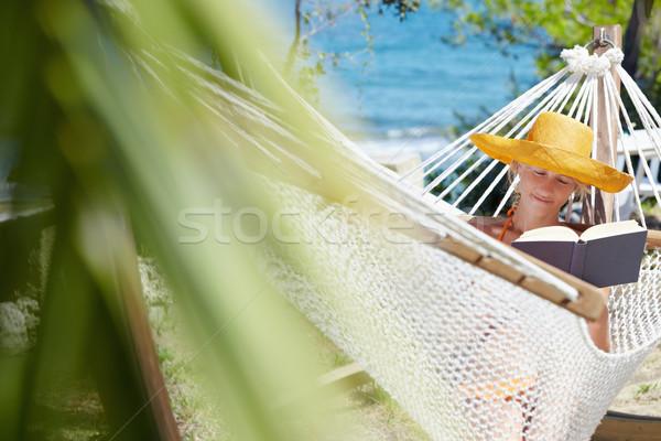 女性 ハンモック 成人 オレンジ 帽子 読む ストックフォト © diego_cervo