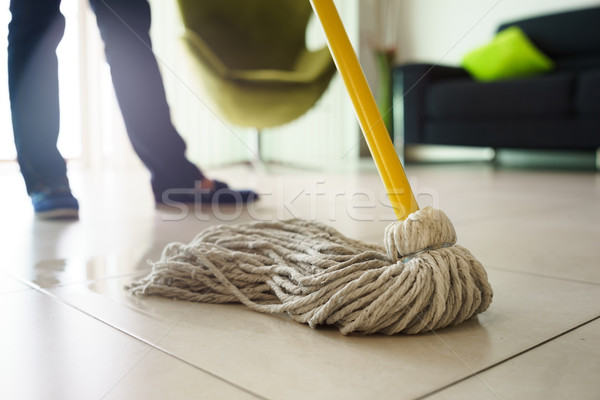 Woman Doing Chores Cleaning Floor At Home Focus on Mop Stock photo © diego_cervo