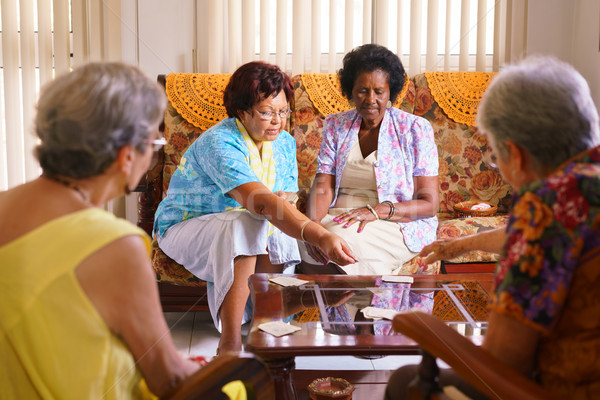 Senior Women Playing Card Game In Hospice Stock photo © diego_cervo