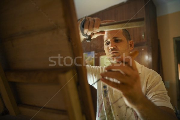 Sculptor Painter Artist Chiseling A Wooden Bas Relief-3 Stock photo © diego_cervo