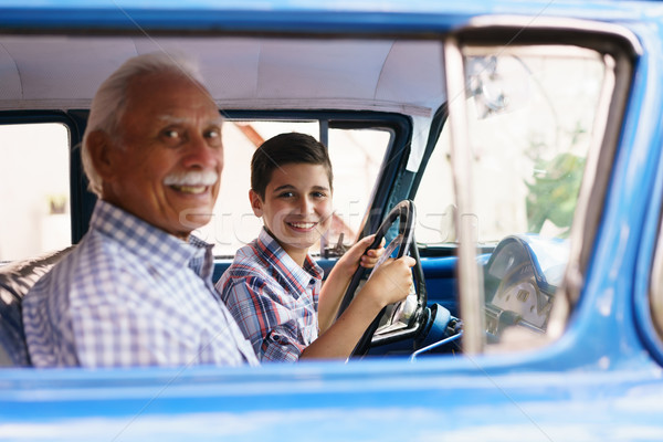 Portrait Grandpa Giving Driving Lesson To Boy In Old Car Stock photo © diego_cervo