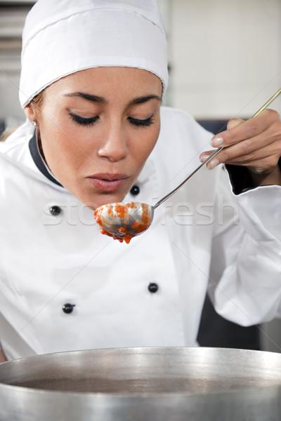 Szakács női kóstolás paradicsomszósz copy space nő Stock fotó © diego_cervo