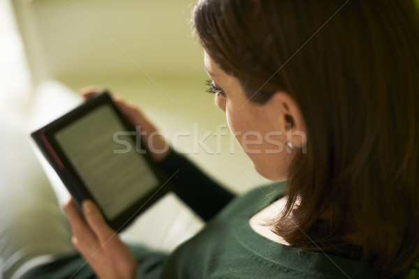 girl studying literature with e-book at home Stock photo © diego_cervo