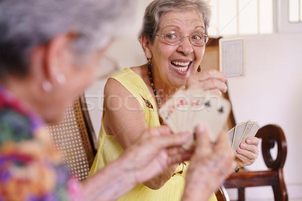 Edad mujeres disfrutar jugando tarjeta juego Foto stock © diego_cervo