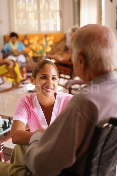Elfekvő nővér hallgat idős férfi tolószék Stock fotó © diego_cervo