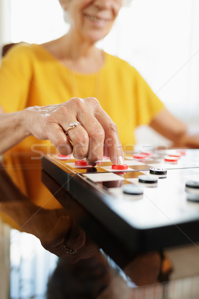 Grandma Playing Checkers Board Game In Hospice Stock photo © diego_cervo