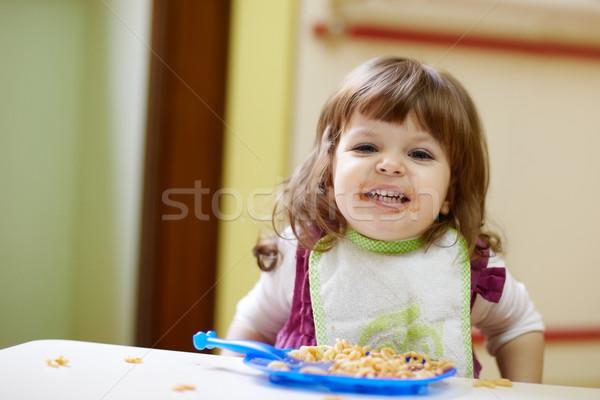 little girl having lunch at kindergarten Stock photo © diego_cervo