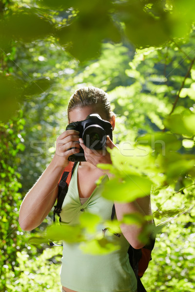 young female photographer hiking in forest  Stock photo © diego_cervo