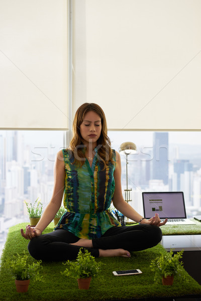 Business Woman Doing Yoga Meditation On Table In Office Stock photo © diego_cervo