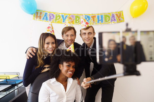 Business People Taking Selfie With Phone At Office Party Stock photo © diego_cervo