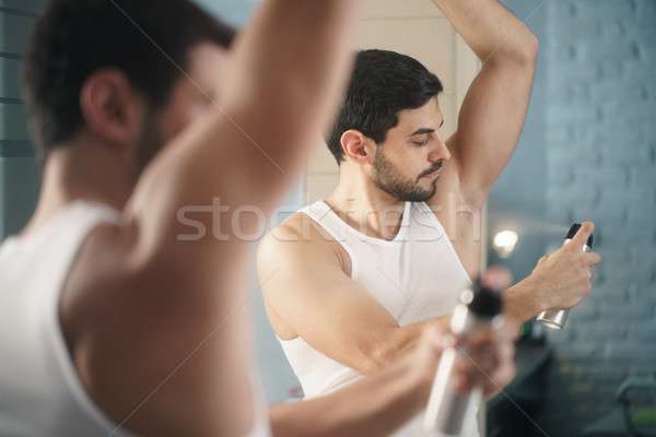 Man Using Spray Deodorant On Underarm For Bad Smell Stock photo © diego_cervo