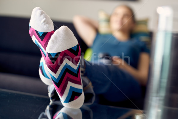 Woman With Feet On Table Watching Film TV At Home Stock photo © diego_cervo