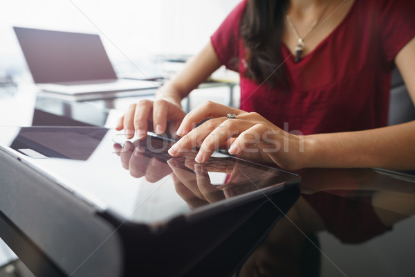 Woman using tablet computer for daily work in office Stock photo © diego_cervo