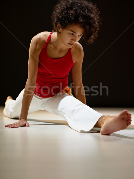 hispanic woman doing leg splits Stock photo © diego_cervo