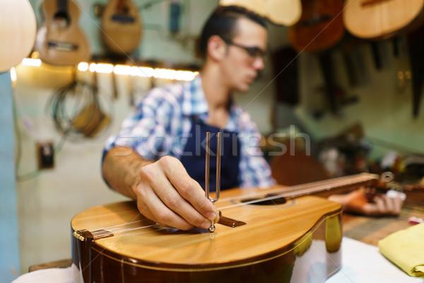 Artisan Lutemaker Tuning Handmade Classic Guitar With Diapason Stock photo © diego_cervo